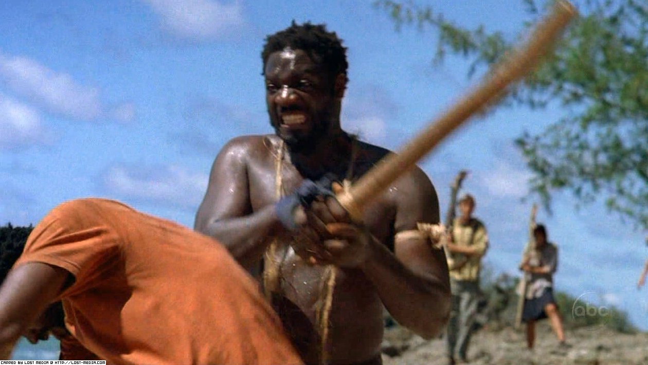 Mr. Eko beating Michael Dawson with his mighty Jesus Stick